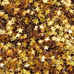 Closeup of golden stars decorative papers closeup